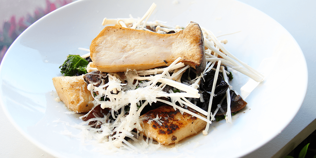 Roasted mushrooms with dressed baby greens, basil pistou